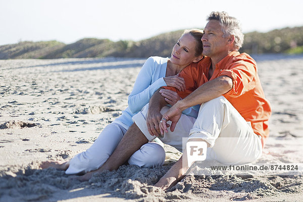Mature Couple Sitting on Beach  Jupiter  Palm Beach County  Florida  USA