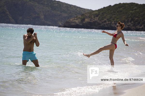 Couple Playing at Beach  Sardinia  Italy