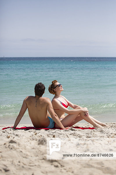 Couple Relaxing at Beach  Sardinia  Italy