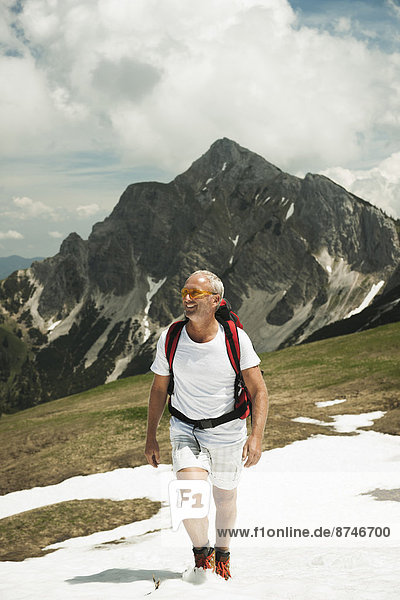 Mature man hiking in mountains  Tannheim Valley  Austria