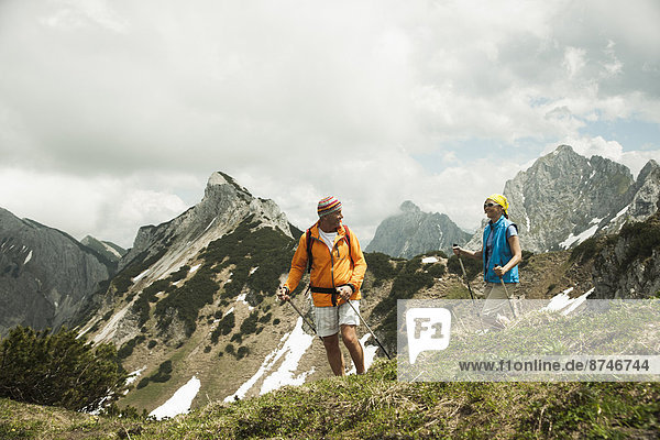Mature couple hiking in mountains  Tannheim Valley  Austria