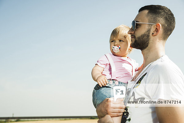 Father Holding Baby Daughter Outdoors  Mannheim  Baden-Wurttemberg  Germany