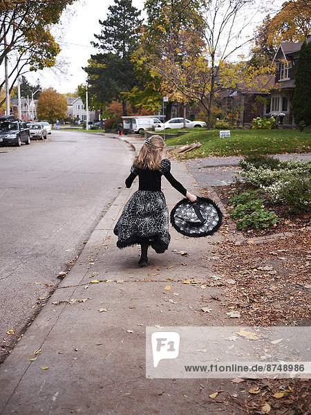 Girl Trick or Treating in Witch Costume  Toronto  Ontario  Canada