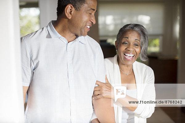 Laughing senior couple in doorway