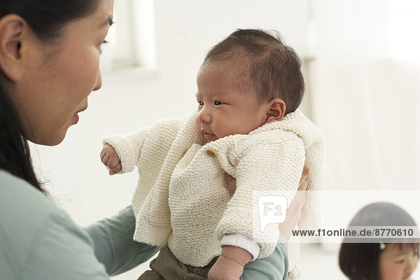 Asian woman with her baby