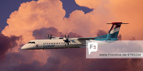 Luxair De Havilland Canada DHC-8-402Q Dash 8 in flight during a thunderstorm