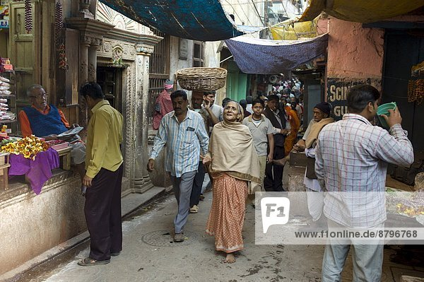 Indian people in alleyway in the holy city of Varanasi  Benares  Northern India