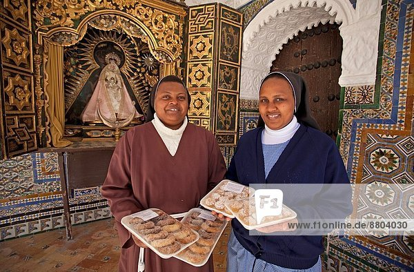 Monastery of Carmona´s St. Clare. Sisters Clarisas Franciscanas teach us a few samples of his confectionary  it departs importantly from the income that they support to his community. Carmona  Seville  Andalusia  Spain  Europe.