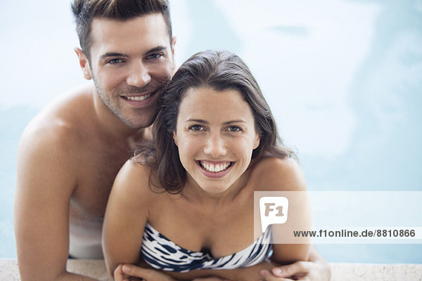 Young couple in pool together  portrait