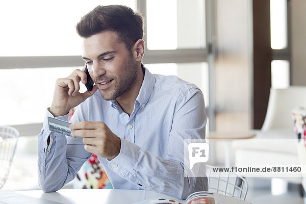 Man making credit card purchase over the phone