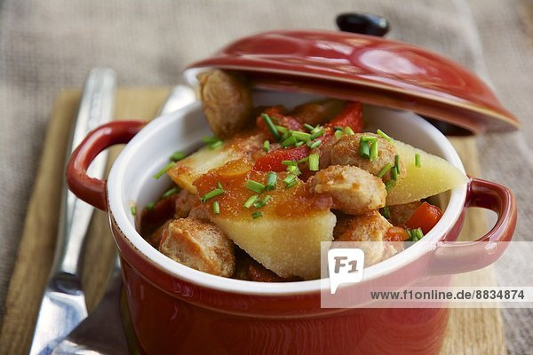 Quince stew with textured vegetable protein chunks and garnished with chives