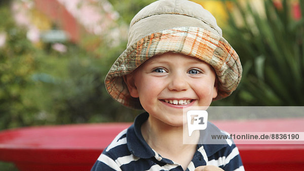 Portrait of smiling little boy wearing sun hat