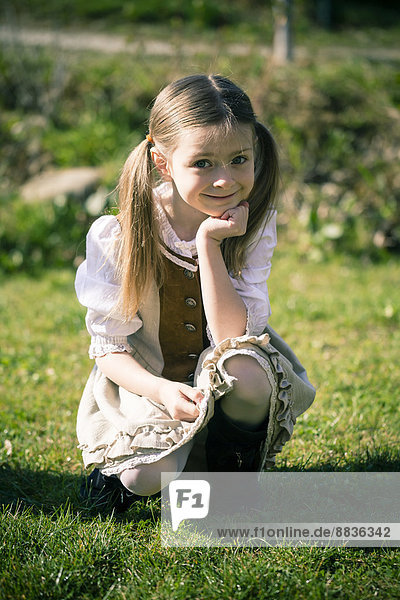 Portait of little girl wearing country style dress