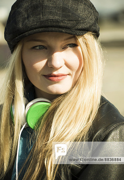 Young woman with cap and head phones  portrait
