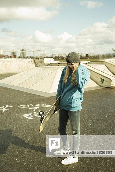 Young woman at skate park