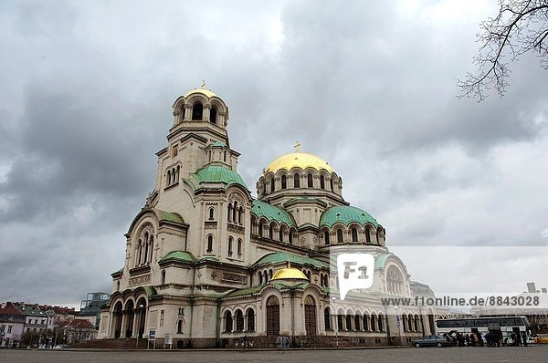 Sofia,  Bulgaria. Exterior of the Eastern Orthodox Aleksander Nevski Cathedral,  seat of the Bulgarian Patriarch,  under cloudy skies.