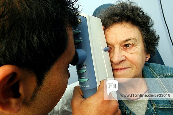 An optometrist examines a patient´s eye with an air_puff tonometer. The instrument is used to measure the intra_ocular pressure which is abnormally high in the eye disease glaucoma. This procedure is an important part of the regular eye exam  which everyo