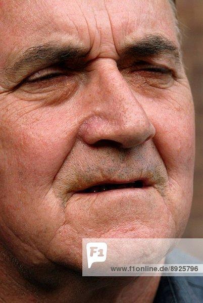 The face of an elderly man.