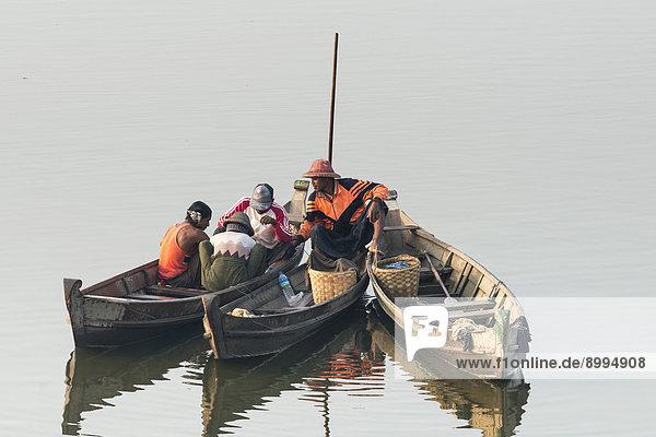 Fishermen in their boats in the morning light  Thaungthaman Lake  Amarapura  Mandalay Division  Myanmar