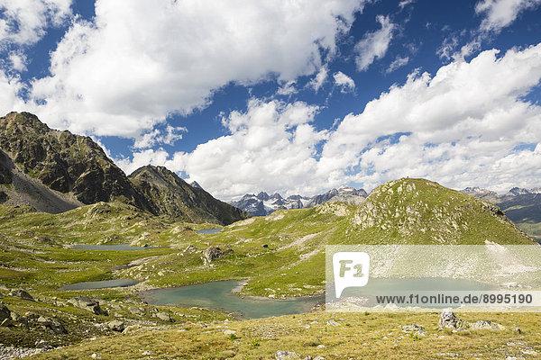 Macun-Seenplateau  Ausblick auf Verstanclagruppe und Silvrettagruppe  Schweizer Nationalpark  Graubünden  Schweiz Macun-Seenplateau, Ausblick auf Verstanclagruppe und Silvrettagruppe, Schweizer Nationalpark, Graubünden, Schweiz