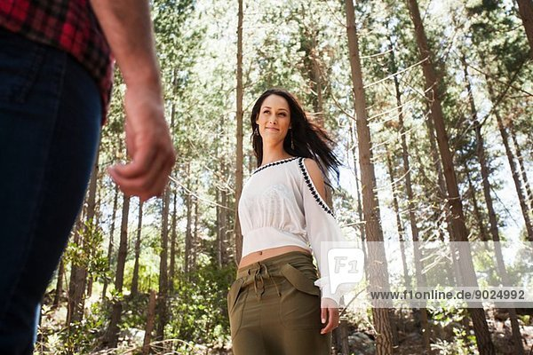 Young woman in forest  looking at partner