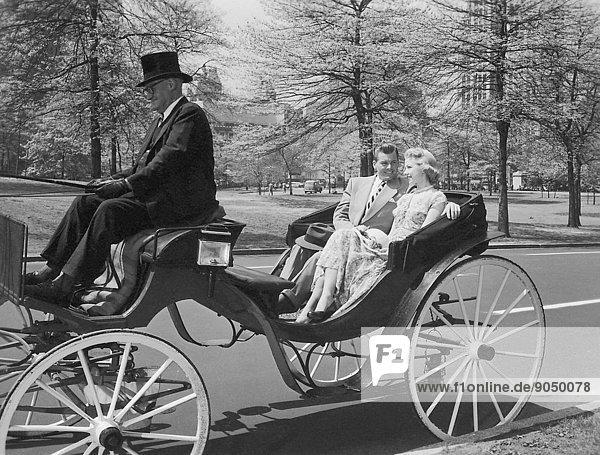 Couple enjoying a carriage ride