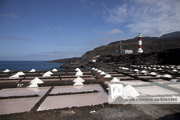 Salt production  Teneguía salt pans  Old Lighthouse and New Lighthouse at the southern cape  Punta de Fuencaliente  La Palma  Canary Islands  Spain