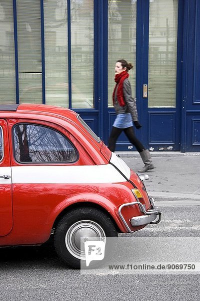 Red car and woman in Paris