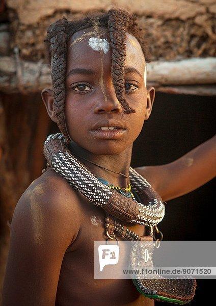 Young Himba Girl With Ethnic Hairstyle  Epupa  Namibia.