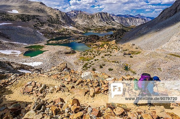 Backpacker on the Bishop Pass Trail  John Muir Wilderness  Sierra Nevada Mountains  California USA.