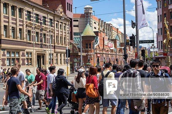 Australia  NSW  New South Wales  Sydney  Haymarket  Chinatown  George Street  pedestrians  street crossing  Asian  man  woman .