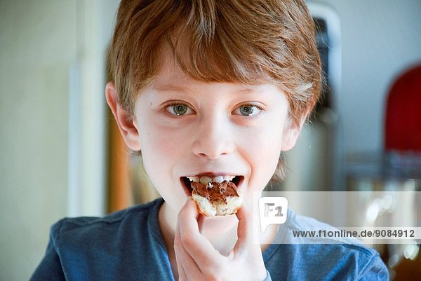 9 years old boy having his breakfast.