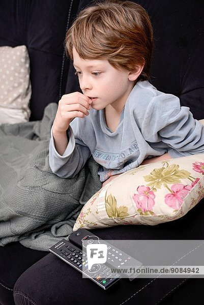 9 years old boy watching television.