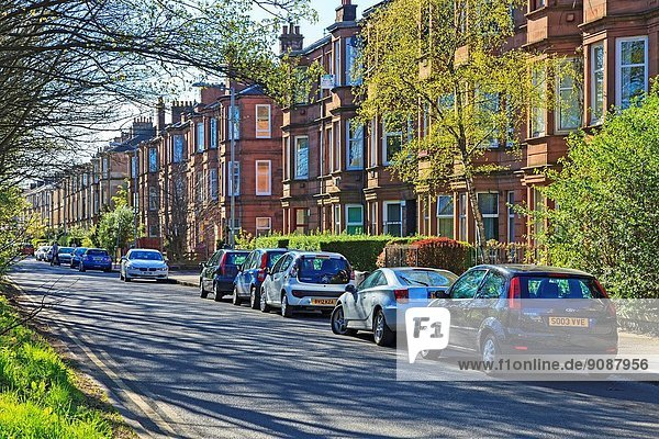 Clifford Street  Govan Glasgow showing a row of traditional red sandstone tenements  common in Glasgow  Scotland  UK.