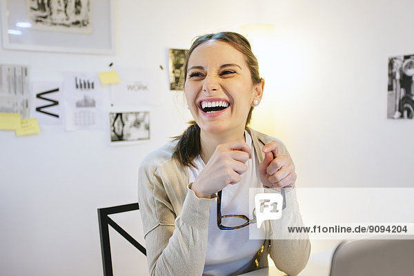 Laughing woman at modern home office
