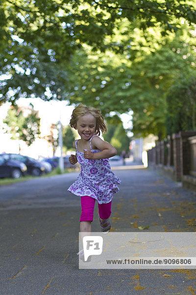 Girl running on walkway