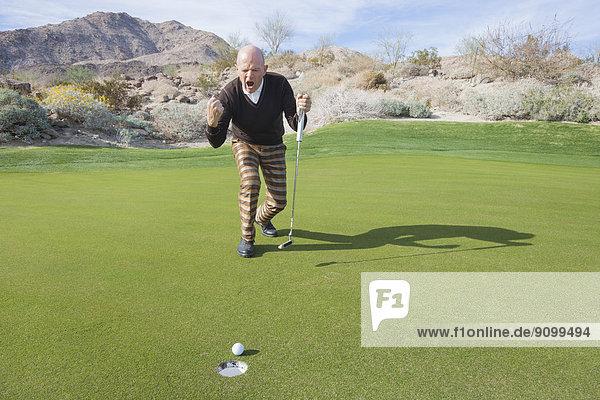 Senior  Senioren  untergehen  Fest  festlich  Golfspieler  Länge  Golfsport  Golf  Kurs  voll  sinken
