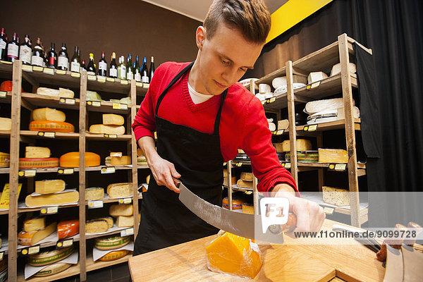 schneiden  Käse  Laden  Verkäufer