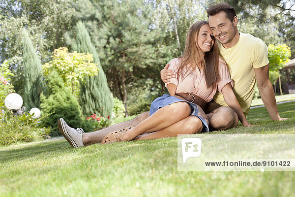 Full length of smiling young couple spending time together in park