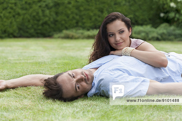 Loving young couple relaxing in park