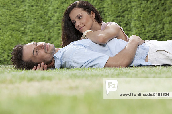 Loving young couple spending quality time in park