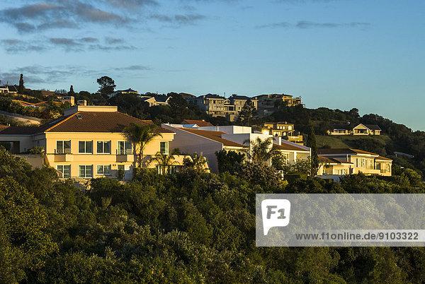 Houses in the morning light  settlement  Plettenberg Bay or Plettenbergbaai  Garden Route  Eden District  Western Cape  South Africa