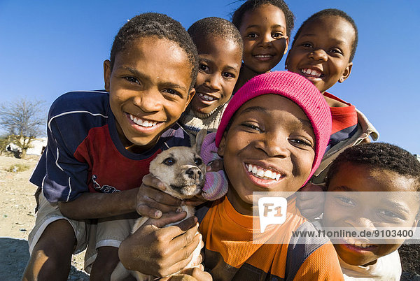 Children with a dog  Graaff-Reinet  Camdeboo  Eastern Cape  South Africa