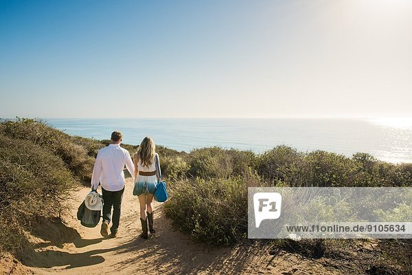 Romantic young couple strolling on coastal path  Torrey Pines  San Diego  California  USA