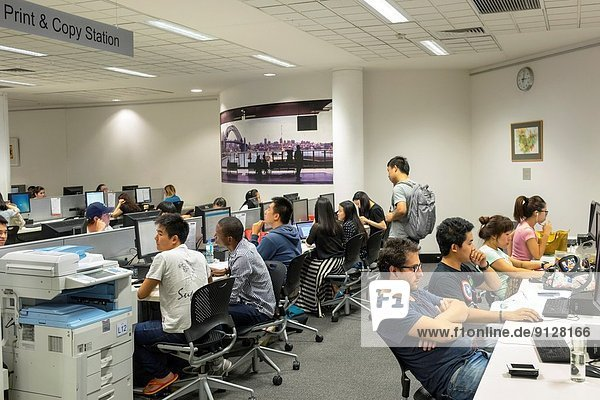 Australia  NSW  New South Wales  Sydney  UTS  University of Technology Sydney  campus  Haymarket Library  education  school  computer  stations  lab  student  studying  Internet access  man  woman  teen  Asian.