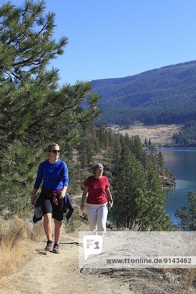 Young woman with mother Hiking Kalamalka Lake Provincial Park  near Vernon  Okanagan  British Columbia  Canada