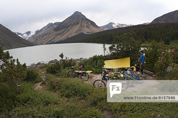 Camp at Lorna Lake. Mountain bike touring in Spruce Lake Protected Area. South Chilcotin Mountains. British Columbia  Canada