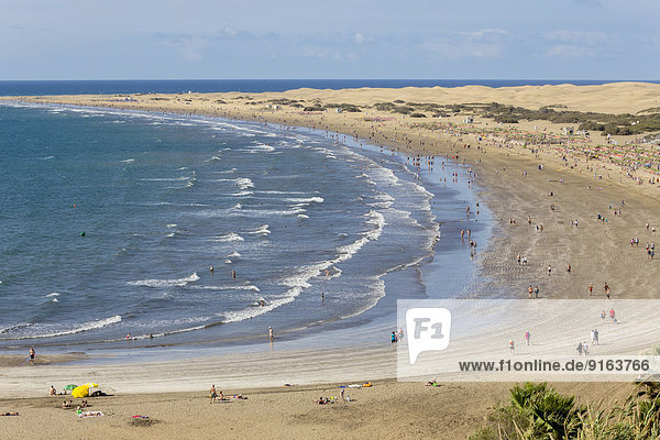 Beach of Playa del Ingles  the dunes of Maspalomas at the back  southern coast of the island  Gran Canaria  Canary Islands  Spain
