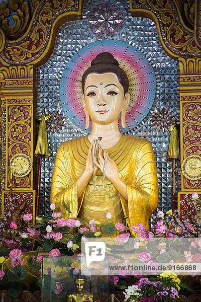 Buddha statue in Dhammikarama Burmese temple  George Town  Penang  Malaysia