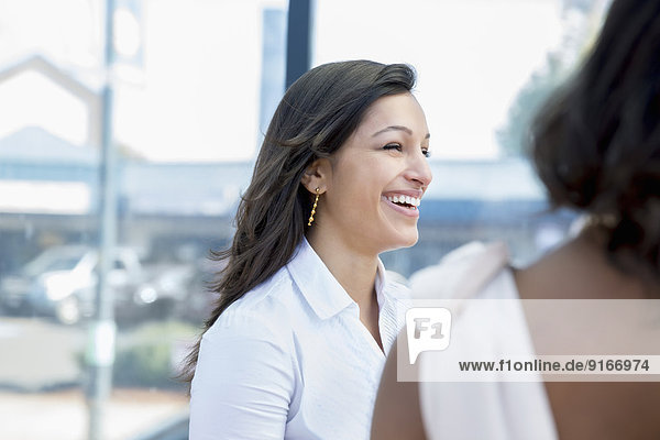 Businesswomen laughing outdoors